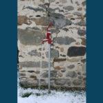 Robinet ouvert sous la neige